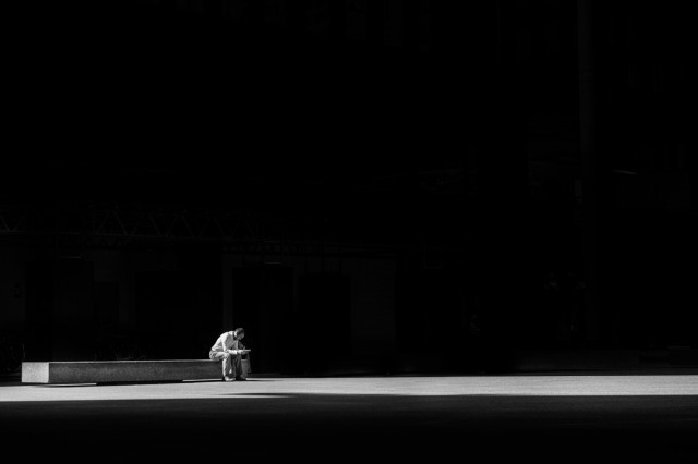 man sitting on a bench alone